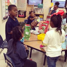 A Few Of The Kindergarters In Mrs. Miller-Johnson's Class Opening Their Gifts