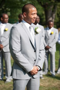 White bout for the groom, yellow bouts for the groomsmen | Photo by http://ambphoto.com Bouts by http://aproposperth.com