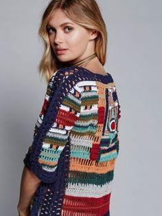 Sybilla Dress | This retro-inspired short sleeve multi-colored crochet dress…