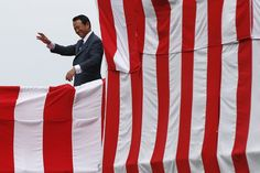 HELLO: Taro Aso, Japan's deputy prime minister and finance minister, waved as he attended the unveiling of the country's biggest warship, dubbed 'Izumo,' since World War II at a ceremony in Yokohama, Japan, Tuesday. (Toru Hanai/Reuters)
