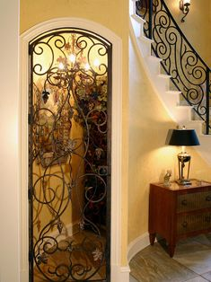 Custom Bar with Wrought Iron Cellar Door - traditional - wine cellar - charleston - by Hostetler Custom Cabinetry Under Stairs Wine Cellar, Wine Cellar Basement, Stair Shelves, Storage Stairs, Closet Storage, Estilo Colonial, Design Rustique, Home Wine Cellars, Tiny House Stairs
