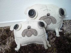 Felt Pugs.  Sew this around a brick or stone and you have a great door stop!