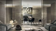 Sistema flotante de Paneles correderos Rimadesio modelo Velaria en aluminio Palladio y vidrio rete bronzo.