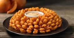 Bloomin' Onion fans, you might want to sit down for this one. The Outback Steakhouse classic can now be yours, in your home, whenever you want. For the uninitiated, the Bloomin' Onion is a legendary a...