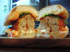 Basil, sun-dried tomato & parmesan slider with spicy marinara + mozz + arugula