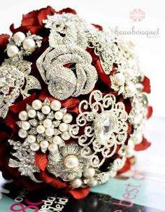 broach bouquet  - love the red ribbon threaded through - perfect for a winter wedding - sparkly
