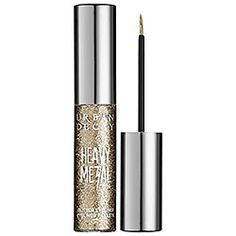 I put this on at Sephora too! It rocks  Urban Decay Heavy Metal Glitter Liner in Midnight Cowboy - beige glitter #sephora