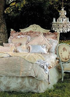 Romantic Shabby Chic...tulle bed skirt, bedding & chandelier.