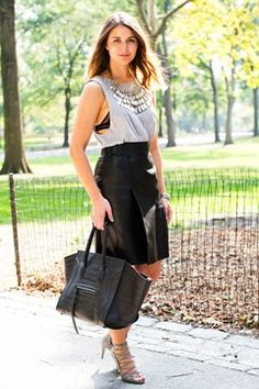 Adore this whole look! Statement necklace, drop arm top & black bottoms.