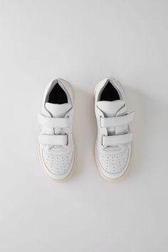 Acne Studios Steffey white sneakers are crafted to a round toe in calf leather and finished with a face motif on the back sole. Sneakers Mode, Sneakers For Sale, White Sneakers, Sneakers Fashion, Shoes Sneakers, Sneakers Design, Jordans Sneakers, Sneaker Stores, Sneaker Brands