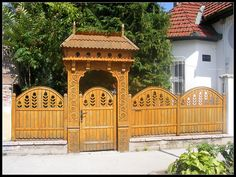 I like how the panels are up on a plinth while the door rests at the sidewalk level. Transylvania Romania, Heart Of Europe, Wooden Gates, Fence, Gazebo, Porch, Sidewalk, Outdoor Structures, Doors