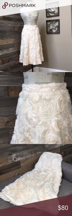 """NWT!! Anthropologie HD in Paris Tufted Midi Skirt 🌸Stunning🌸 NWT!! Anthropologie HD in Paris Tufted Blossoms Midi Skirt. Cream color size 2. Waist 26"""", length 27"""". Last picture shows a slight imperfection. It looks like tape was on there and left a light mark but it blends with the color of the skirt, the last picture shows it right by the top of the measuring tape. Anthropologie Skirts Midi"""