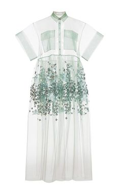This short sleeved sheer tulle **Delpozo** dress features a high round neck with thin collar, flap pockets at the front, floral sequin embelishments at the waist and a babydoll shape.