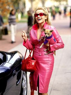 Reese Witherspoon's wardrobe in Legally Blonde is so creative and adorable.  Lots of pink, tight skirts, sexy dresses, spike heels. designer handbags and sunglasses, and of course the chihuahua as accessory -- anything to define her as flashy and superficial and frivolous.  As the ultimate girly girl, her character Elle Woods has a different hairstyle in every scene.