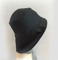 This is the lovely Eleanor with a brim set for a rainy day! Eleanor is designed with the flapper styles in mind but her brim is all about keeping you dry.With a