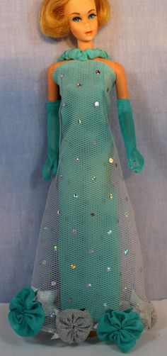 Barbie's mod era evening gown, 'Extravaganza', in a beautiful blue reproduction color variation. The original was hot pink. I don't usually like reproductions, but this color and construction is beautiful