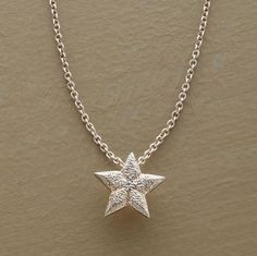 "Luck shines on those who believe in it. Wish upon our diminutive sterling silver star, suspended from a delicate silver chain, and anything is possible. Spring ring clasp. 16""L."