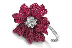 Magnolia brooch featuring mystery-set rubies by Van Cleef & Arpels. Image by Christie's.