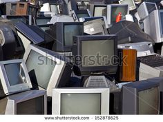 Unwanted televisions piled up for recycling at government collection point - stock photo
