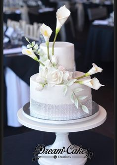 2 Tier bling wedding cake with sugar calla lilies, roses, baby roses,