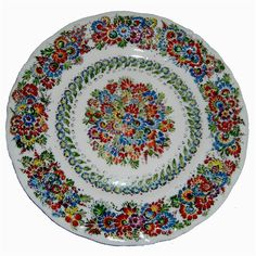 Beautiful hand painted porcelain plate with floral design. These artistic works are made in the town of Opole. Made in Poland.