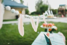 Feather garland at Boho Birthday Bash - Photo by Summer Nicole Photo