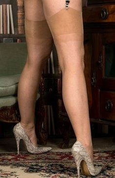 Nude stockings with snake high heels.