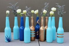 Beer bottle DIY bud vases - 7 Budget Friendly and Recycled Craft Ideas - perfect for a rainy day activity to DIY the night away!