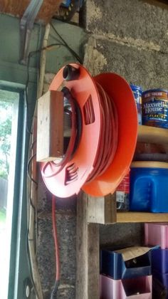 Extension cord reel in a fixed space