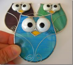 stained glass owl shattered by light blue