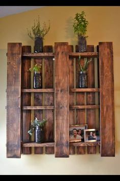 Find a standard shipping pallet- buff with sandpaper if you want a smoother finish or leave it rough for a more rustic finish. Purchase stain (clearance and discontinued stains are less expensive)- mount- I would use a traditional hanging mount with eye hooks and wire. This would allow easier placement as well as tilting it slightly for changing the weight on a wall.