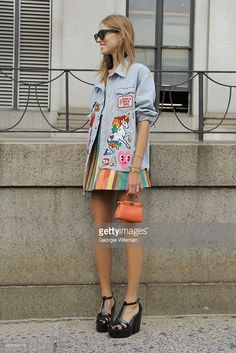 Chiara Ferragni is seen on the streets of Manhattan outside of the Jeremy Scott Spring 2016 fashion show at Skylight at Moynihan Station wearing small orange Fendi bag, vintage denim jacket with badges, Jeremy Scott striped plastic skirt and matching crop top, black Melissa shoes and Cline black sunglasses on September 14, 2015 in New York City.