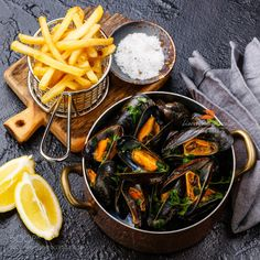мидии и фри by l-i-s-k-a  IFTTT 500px stone Mussel black clam cooked copper dark dish edible food french fries lemon meal mu