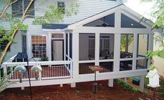 A small extension off this screened porch contains a captured doorway leading…