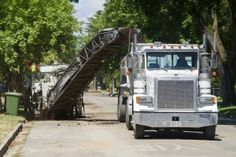 Asphalt grinder tears up road for water main project - Lodinews.com: News