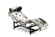 Upholstered cowhide reclined lounger on a painted stainless frame Specifications: Length 67