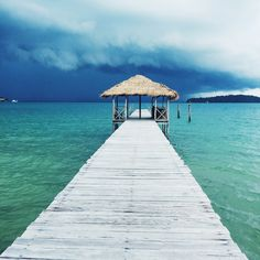 A mid afternoon storm on Koh Rong Samloem #travel #cambodia #vacation #pier #blue #turquoise #photography #georgeats