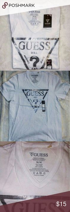 Guess V Neck Graphic White T Shirt Perfect T shirt for you little Uzi vert and Young thug lovers. All white T with a glittery guess logo. You can twirl and sachet while packing your heat in style. A great shirt for all the sassy savages out there. Goes great with the skinny jean sparkly Robbins. Guess Shirts Tees - Short Sleeve