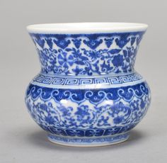 A BLUE AND WHITE ZHADOU, Qing Dynasty. The zhaodou is short wide single gourded-shaped. The exterior is decorated with lotus flowers, connective vines, leaves and surrounded by imperial designs. The bottom of the piece is decorated with a Chinese seal. The zhadou is blue and white color. 3 3/16 in. tall.