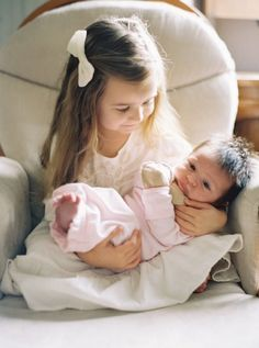 Such a beautiful photo I found of looks like a big sister holding her new baby sister. Love is the greatest and most important thing in life. Photo by: Kurt Boomer Cool Baby, Baby Kind, Pretty Baby, Precious Children, Beautiful Children, Beautiful Babies, Children Photography, Newborn Photography, Family Photography