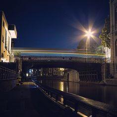by travelformotion: #light #trail #gent #bridge #ghent #visitgent #tram #light #evening #darkness #walkway #long #exposure