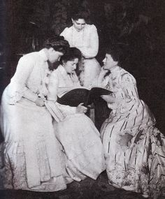 Tsarina Alexandra (center) reading with sisters Elizabeth Feodorovna (behind), Princess Irene of Hesse (right) and Princess Victoria (left).