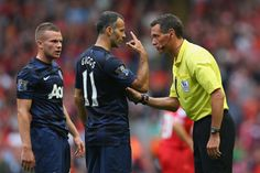 Referee Andre Mariner has words with Ryan Giggs