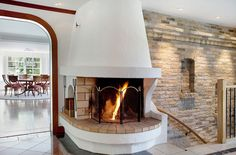 white brick home ideas | ... white fireplace staircase brick wall white wall wooden floor dining