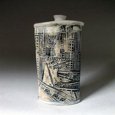 White Linocut Relief Print Ceramic Porcelain Bottle/ Vase with Images of City Traffic, via Etsy.