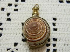 Vintage sea shell perfume pendant in brass by VogelHausVintage, $16.00