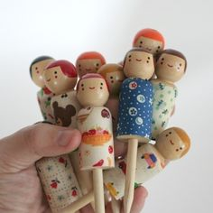 these are actually birthday-candle-holders!  the candles sit in a hole on top of their pretty heads : )  Cute.