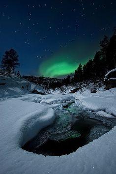 Aurora Borealis by Tennevik River in Troms, Norway   by Arild Heitmann Photography, via Flickr