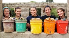 A beautiful rainbow of work buckets and smiling faces on our work site within the community.
