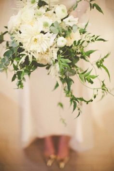 Ivory bouquet with ivy: http://www.stylemepretty.com/missouri-weddings/st-louis/2015/04/17/classic-st-louis-cathedral-wedding-with-a-stylish-twist/ | Photography: Hawes - http://www.hawesphotography.com/